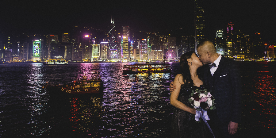 Landscape with bride and groom wedding in Hong Kong in the Night