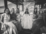 The bride is with her bridesmaids on the speedboat